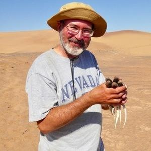 Photo of Al Muth, PhD Holding Lizards at Boyd Desert Center for Research